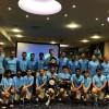 عشرون طفلًا يتعلمون اللغة الإنكليزية وكرة القدم في ملاعب مانشستر سيتي في إنكلترا